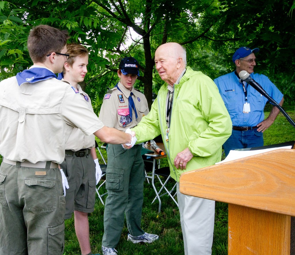 Stephen Bechtel shaking hands with Scouts