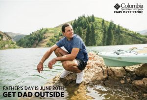 Father's Day promo for Columbia Sportswear showing man crouching on a rock on the shoreline of a lake.