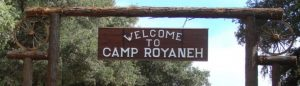Welcome to Camp Royaneh sign at camp entrance.