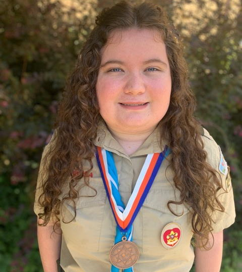 Picture of Sierra from Troop 2220 wearing her Thomas Edison STEM Super Nova award medal.